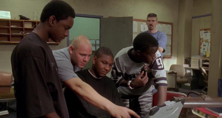 El personatge de 'The Wire' Herc és un policia que es passa a la seguretat privada (el segon per l'esquerra). Imatge: HBO.
